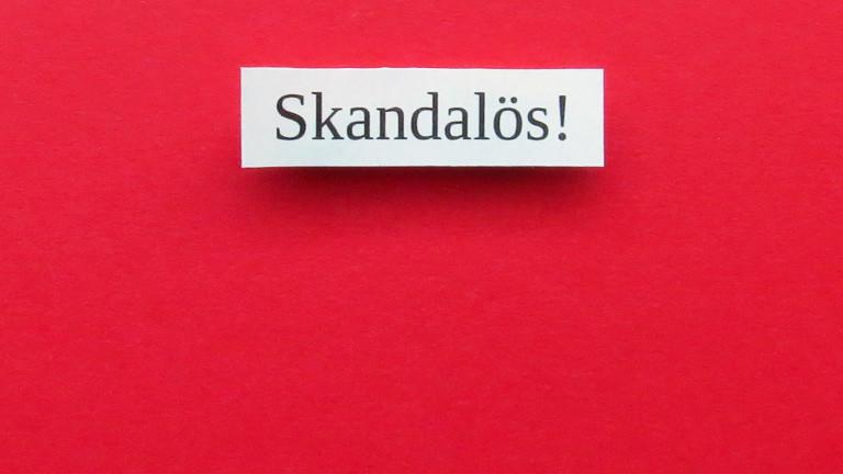 """Bild mit der Aufschrift """"Skandalös!"""""""