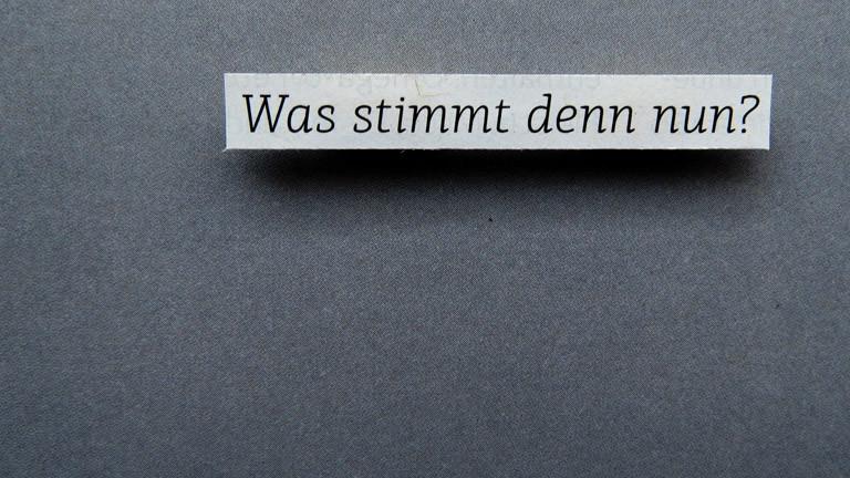 """Der Schriftzug """"Was stimmt denn nun?"""""""