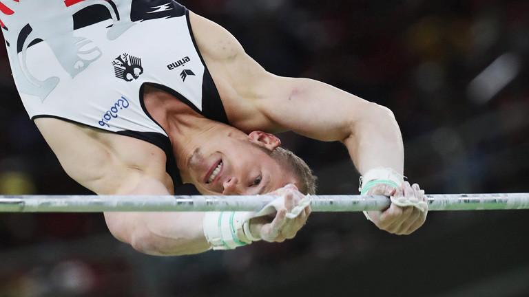 Der Sportler Fabian Hambüchen am Reck bei der Olympia 2016; Foto: dpa
